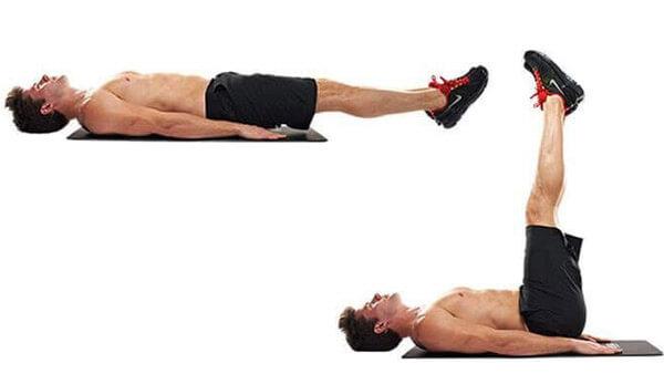 Подъем ног лежа: фото.