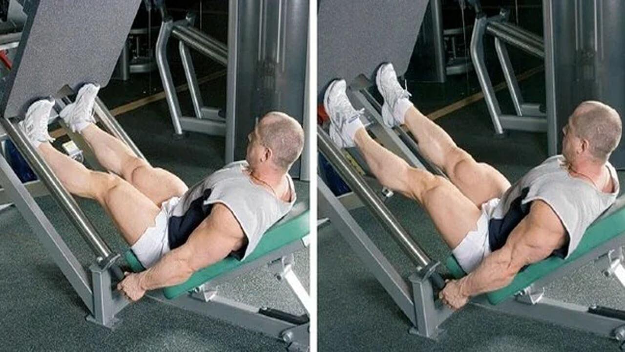 Жим носками в тренажере для жима ногами.